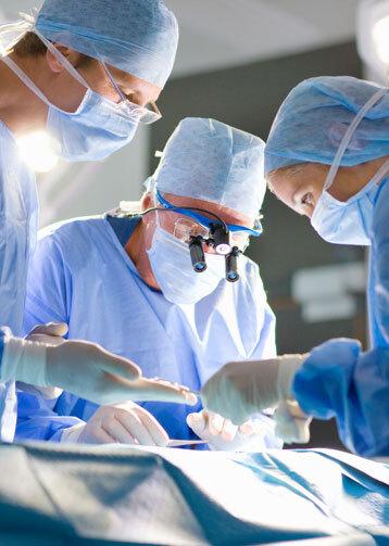 Surgeons conducting surgery